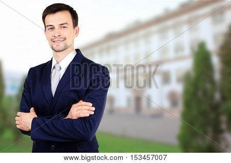 Young man blurred building background. School and education concept.