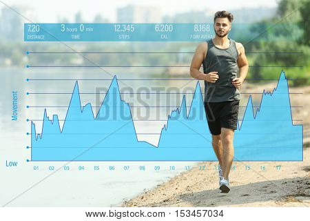 Young man jogging on beach. Graphic of training results. Health care and sport concept.