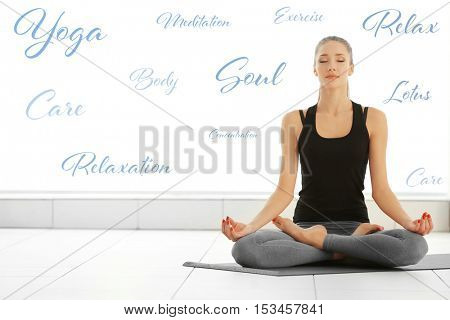 Young woman meditating at home. Yoga and health care concept.