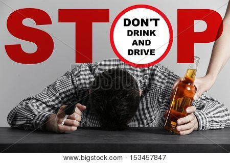 Drunk young man with car key and beer bottle at bar. Word STOP and text DON'T DRINK AND DRIVE on background.