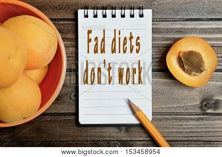 Fad diets don't work words on notepad