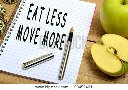 Eat less move more words on notepad