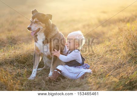 One Year Old Baby Lovingly Holding Her Pet German Shepherd Dog