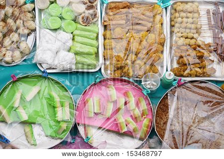 Overhead shot over variety of delicious and colorful Malaysian home cooked local cakes or