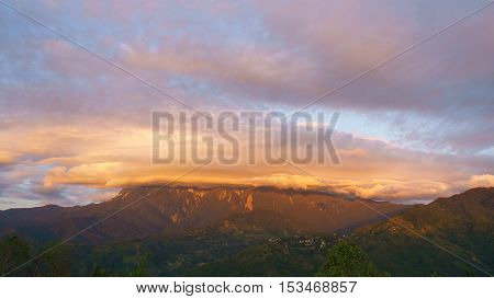 Dramatic cloud formation over Mount Kinabalu in Sabah Malaysian Borneo during sunset.