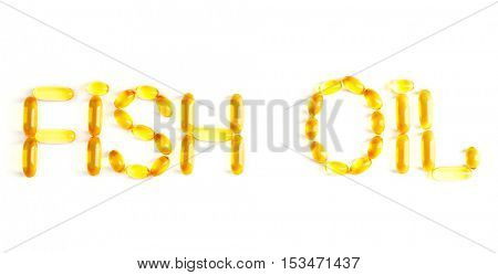 Phrase FISH OIL made of cod liver oil capsules on white background