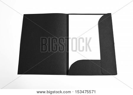 Opened file folder with white paper in it