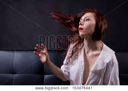 Side View Portrait Of A Red Hair Model