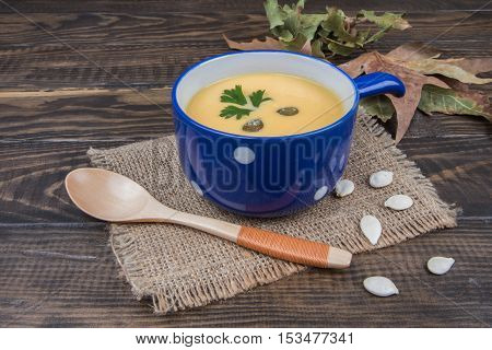 A Bowl Of Pumpkin Soup On Napkin Sackcloth