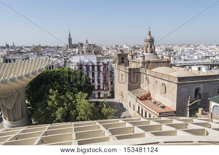 View from Metropol Parasol of Annunciation church Collegiate Church of the Divine Savior Seville Cathedral and Giralda Seville Spain. Vista desde el Metropol Parasol de la Iglesia de la Anunciación Iglesia colegial del divino Salvador Catedral de Sevilla
