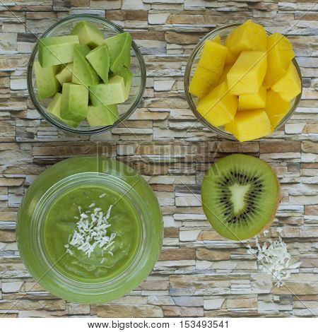 Mango avocado green smoothie with desiccated coconut