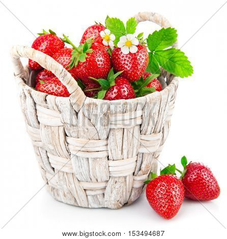 Basket fresh strawberry with green leaf and flower. Isolated on white background