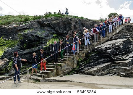 A Coruna Spain - May 29 2016: Turists visiting Cathedrals beach (playa de las catedrales) Spain Atlantic ocean. Famous beach in Northern Spain. Natural rock arch on Cathedrals beach in low tide (Cantabric coast Lugo (Galicia) Spain).