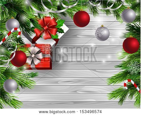 Christmas New Year design light wooden background with christmas tree and silver and red balls and candy canes with gift boxes
