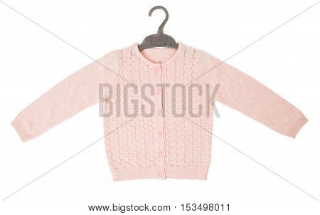 Pink knitted cashmere cardigan on black plastic hanger. Isolated on a white background.