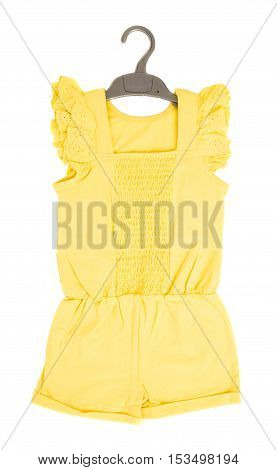Yellow frilled coton overall on black plastic hanger. Isolated on a white background.