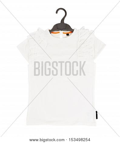 White cotton frilled t-shirt on black plastic hanger. Isolated on a white background.