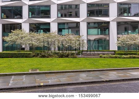 London United Kingdom - April 2016: Cropped street view of a commecial office building. Frontal facade