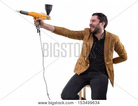 Funny brunette man with powder spray on white background