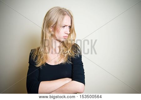 Young Blonde Woman Angry And Sullen Portrait