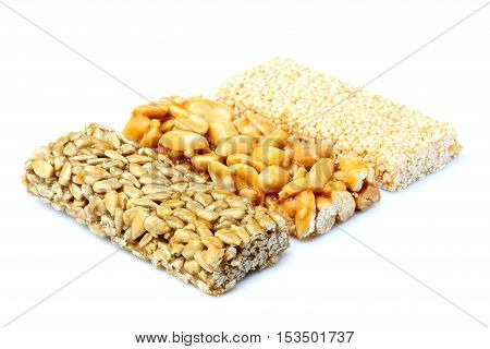 Bars with peanuts sesame and sunflower seeds isolated.