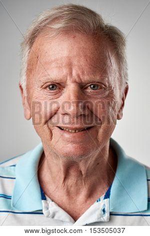 Happy smiling caucasian white man portrait of person in studio.
