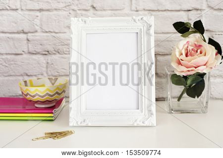 Frame Mockup. White Frame Mock Up. White Picture Frame With Single Flower Rose. Product Frame Mockup