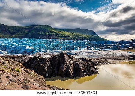 Big and blue Vatnajokull glacier and mountains Iceland