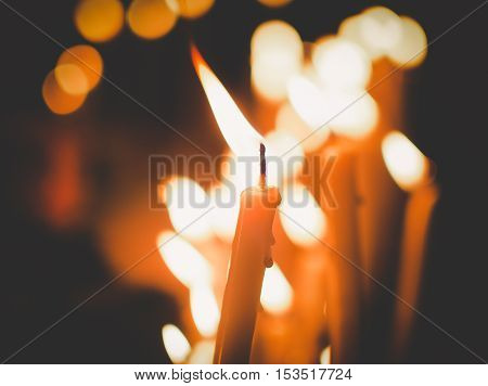 alone, background, black, blinking, bright, burn, candle, candles, celebration, christian, church, closeup, day, decoration, depth, fire, flame, flare, focus, foreground, glowing, heat, hope, illuminate, illuminated, image, light, love, meditation, myster
