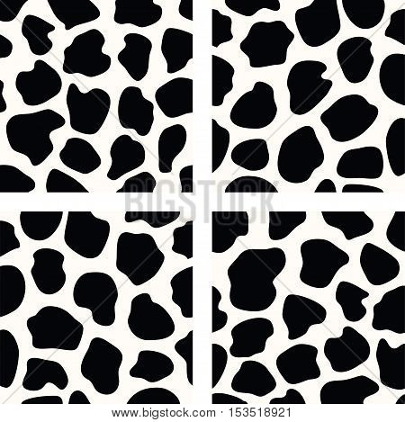 vector black and white set of seamless cow skin patterns