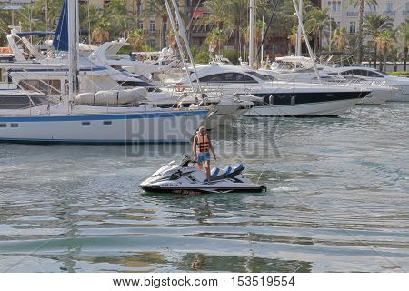 ALICANTE SPAIN - AUGUST 31: man driving jet ski in the port of alicante. Picture taken on August 31 2016 in Alicante spain.