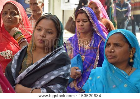 UDAIPUR, RAJASTHAN, INDIA - FEBRUARY 07, 2016 - Unidentified indian women in traditional colorful saree walking on the streets of Udaipur
