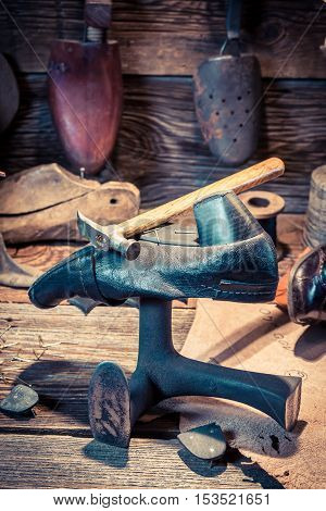 Vintage Shoemaker Workshop With Tools, Shoes And Leather