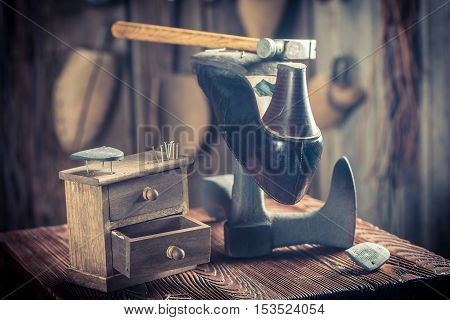 Aged Shoemaker Workshop With Tools, Shoes And Leather