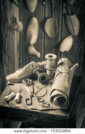 Aged Cobbler Workshop With Tools, Shoes And Leather