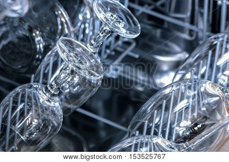 Shining glasses and dishes washed in the dishwasher