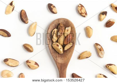 Brazilian Nuts into a spoon. Castanha do Para isolated on white background