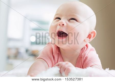 Happy Newborn Baby Girl Smiling