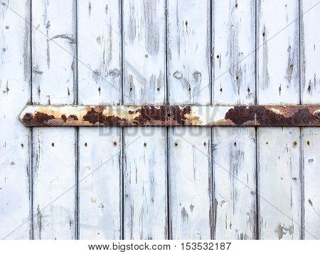 Old door with a rusty door hinge.