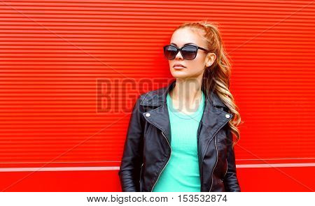 Fashion Portrait Beautiful Woman In Sunglasses Black Rock Jacket Over Red Background