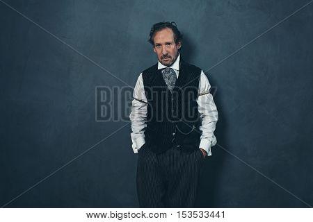 Vintage 1900 Western Man Leaning Against Wall.