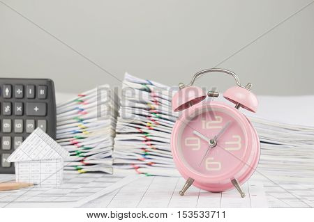 Old Pink Alarm Clock Have Blur House As Background