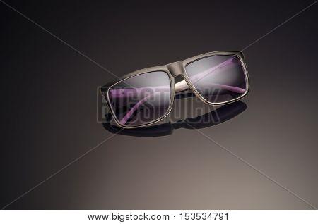 Unisex sunglasses on dark background. Mens sunglasses. Women sunglasses
