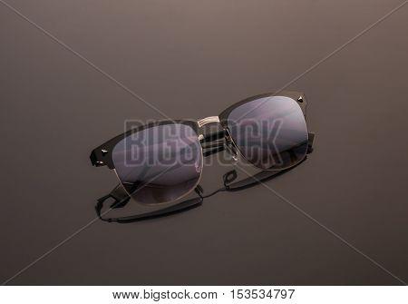 Sunglasses on dark background. Polaroid unisex sunglasses