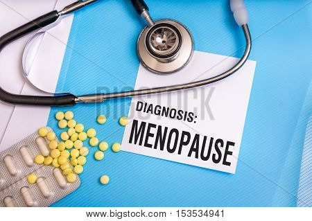 Menopause Word Written On Medical Blue Folder