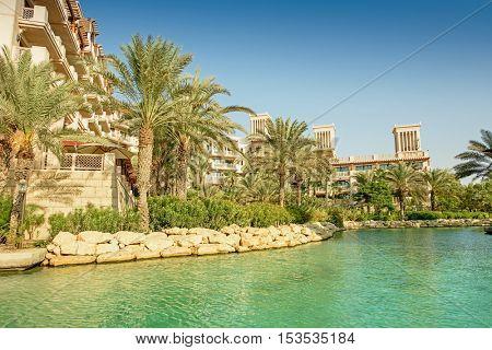 DUBAI, UAE - OCTOBER 06, 2016: Waterfront villas on the Madinat Jumeirah Al Qasr hotel. Madinat Jumeirah houses three iconic hotels in Dubai, also including Mina Salam and Burj al Arab