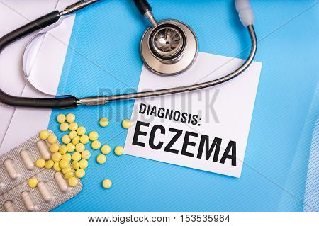 Eczema Word Written On Medical Blue Folder With Patient Files