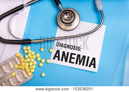 Anemia Word Written On Medical Blue Folder With Patient Files