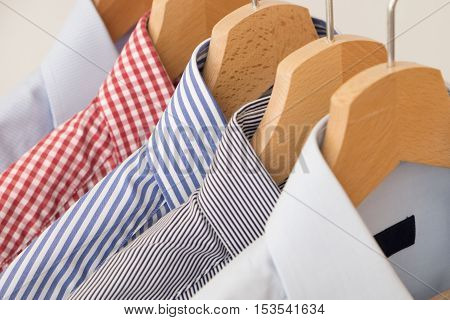 Shirts in several colors and textures in a wardrobe