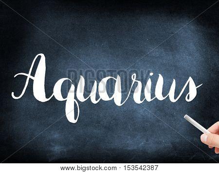Aquarius written on a blackboard